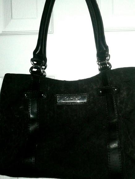 859388246fa Calvin Klein Handbags - Calvin Klein women's Black Signature Handbag